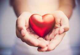 Hand give red heart for love
